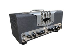 Isolated steel texture and black knob on the control panel of US Style modern electric guitar power amplifier for blues and rock genre on white background with clipping path. side view photo