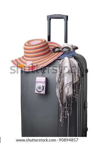isolated still life suitcase with female accessories