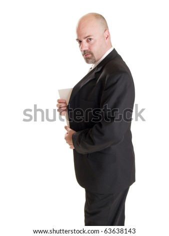 Isolated stock photo of a caucasian businessman looking at the camera while showing the corner of a secret document he has hidden in his coat.