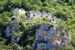 Isolated stone houses on the top of the mountains and surrounded by Lozère forest in France.