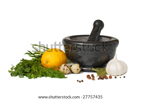 Isolated stone mortar and pestle bowl with ingredients. Onion, pepper, eggs, lemon, garlic, parsley, dill.