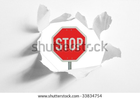 isolated stop sign in a paper hole