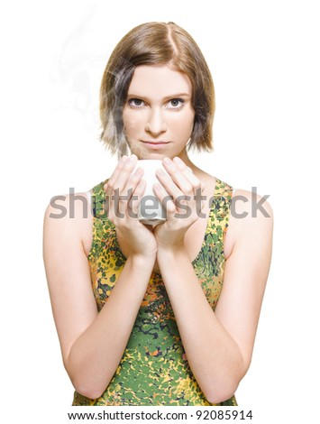 Isolated Studio Portrait Of A Pretty Woman Looking On Camera While Smelling The Aroma In The Steam Of A Fresh Hot Coffee When Holding A Cup Close To Her Face