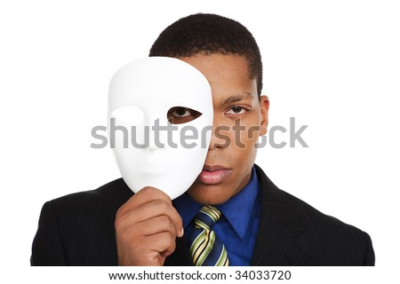 Isolated studio shot of a businessman holding a blank costume mask up to his face and looking at the camera.