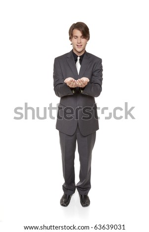 Isolated studio shot of a businessman holding out his hands, cupped as if he were holding something delicate.