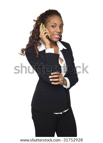 Isolated studio shot of a businesswoman talking on her cellphone.