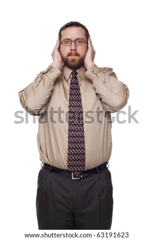 Isolated studio shot of a Caucasian businessman in the Hear No Evil pose.