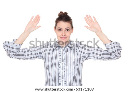 Isolated studio shot of a Caucasian woman holding her hands up in the air as if being robbed.