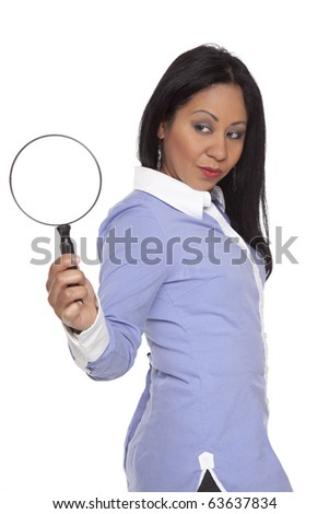 Isolated studio shot of a Latina businesswoman looking at a magnifying glass.
