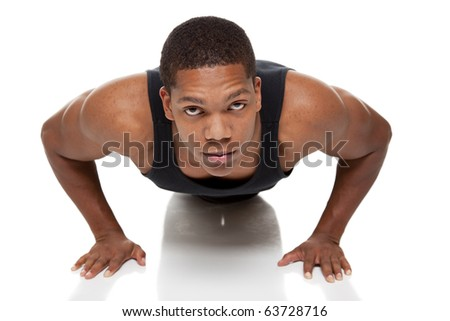Isolated studio shot of a muscular man doing pushups
