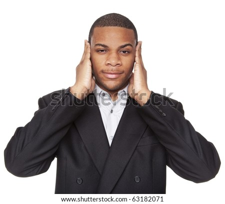 Isolated studio shot of an African American businessman in the Hear No Evil pose.
