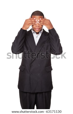 Isolated studio shot of an African American businessman in the See No Evil pose.