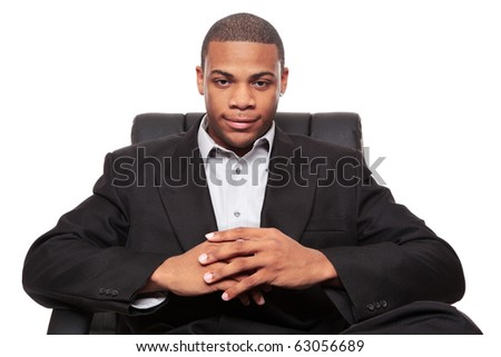 Isolated studio shot of an African American businessman relaxing in a nice office chair.