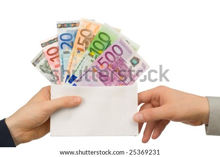 Isolated studio shot of Euro notes in an envelope being handed from one person to another