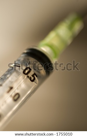 isolated syringe on dramatic background