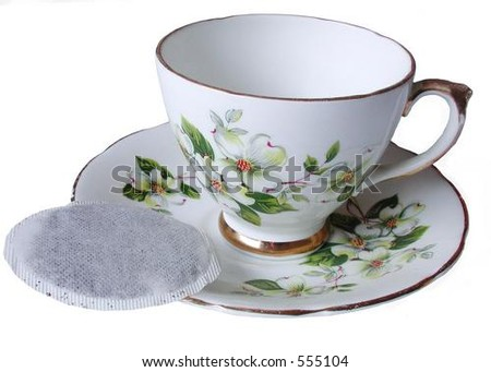 isolated tea cup and saucer with tea bag on side