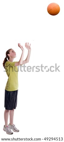 isolated teen age girl throwing a basketball