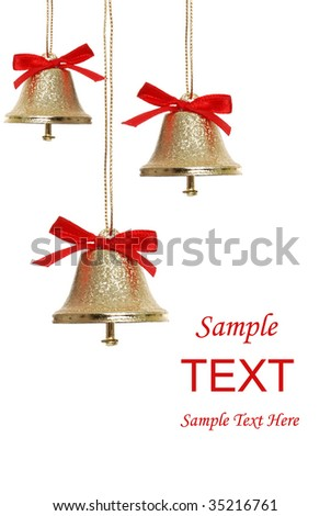 Isolated three golden Christmas bells on white background