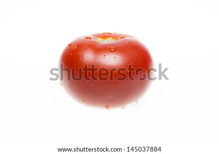 isolated tomato with water drops