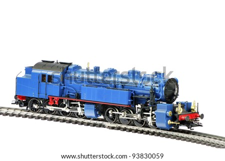 Isolated toy steam locomotive with a coal trailer