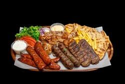 Isolated / Transparent Greek / Arabic Restaurant Grilled Meat Platter, Lamb, Beef, Chicken, Pork Kebab Skewers Sauce Tahini Feta Fries Chips Salad Sausages