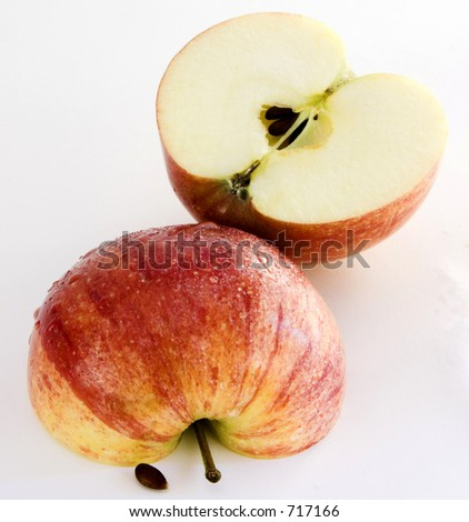 Isolated Two halves of a wet apple over white background