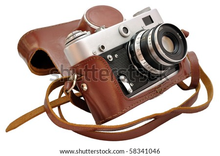 Isolated used vintage film photo-camera in leather case - stock photo