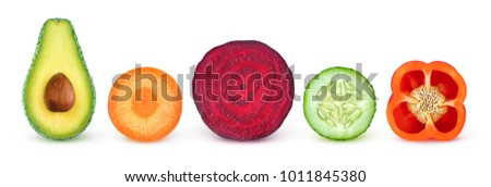 Isolated vegetable slices. Fresh vegetables cut in half (avocado, carrot, beetroot, cucumber, bell pepper) in a row isolated on white background with clipping path #1011845380