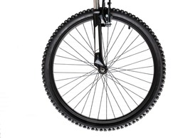Isolated view of a bicycle front wheel mounted on the forks