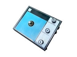 Isolated vintage black and blue octave stompbox electric guitar effect  for studio and stage performed on white background with clipping path. side view photo.  music concept.