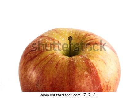 Isolated wet apple over white background