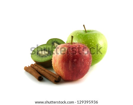 Isolated wet green and red apples and kiwi with cinnamon pods (white background). Fresh diet fruit (water drops). Healthy fruit.
