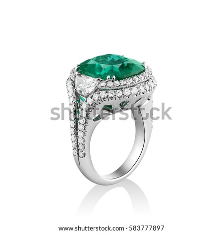 Isolated white gold ring with diamonds and huge green emerald