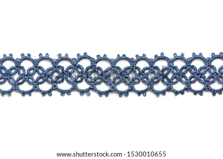 Isolated wicker bracellet or necklace blue color. Lacy weave. Tatting. Handmade jewelry made of mercerized cotton or silk Photo stock ©