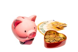Isolated with white background fifty euro banknote money and cent coins in heart money bag. Piggy bank in close up. Finance concept