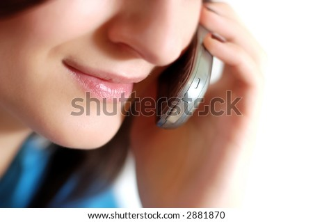 Isolated woman face while speaking to the phone.