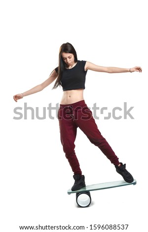 Isolated women on Deck for balance board. Rocker-roller boards. Isolated oval wooden deck for balance board. solid plastic roller for balance board. Rocker-roller boards. Isolated