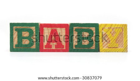 "Isolated Wood Alphabet Blocks Spell the Word ""BABY"""