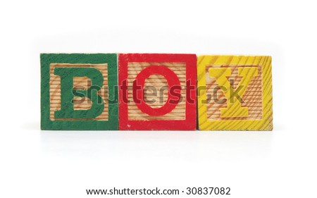 "Isolated Wood Alphabet Blocks Spell the Word ""BOY"""