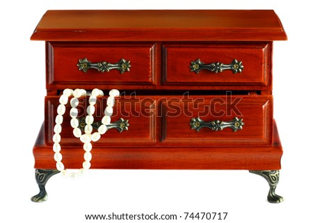isolated wooden chest of drawers for jewelry