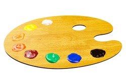 Isolated wooden palette with multi-colored paints. Artist's palette