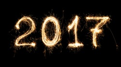 isolated 2017 written with Sparkle firework on black background , 2017 Happy New Year background concept.