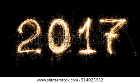 isolated 2017 written with Sparkle firework on black background , 2017 Happy New Year background concept. #514025932