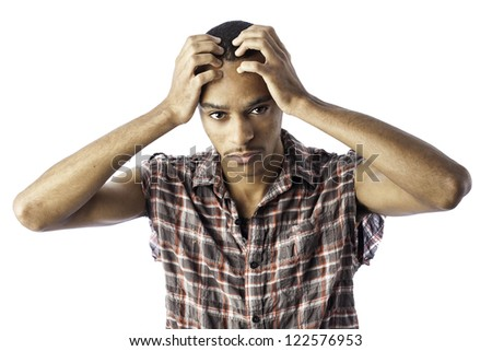 Isolated young african american black male with an expression for either pain, sorrow, headache, thinking or sadness.