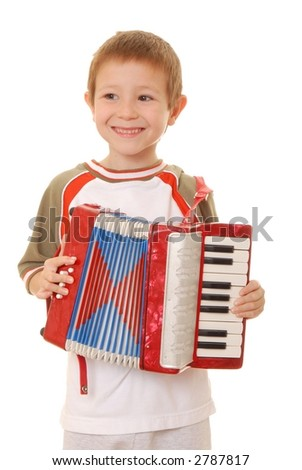 Isolated young boy playing a diatonic accordion