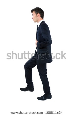 Isolated young business man foot up