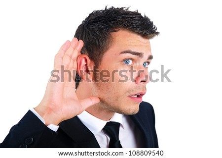 Isolated young business man listening