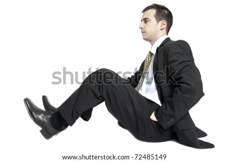 Isolated young business man profile standing down