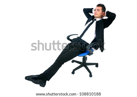Isolated young business man relaxing on chair