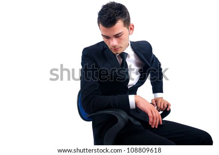 stock-photo-isolated-young-business-man-sitting-on-chair-108809618.jpg